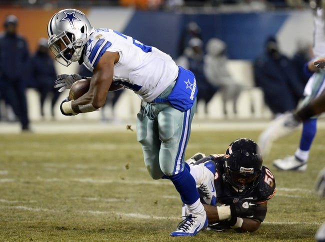 Dec 9, 2013; Chicago, IL, USA; Dallas Cowboys running back Joseph Randle (21) rushes the ball against Chicago Bears outside linebacker James Anderson (50) during the fourth quarter at Soldier Field. Mandatory Credit: Mike DiNovo-USA TODAY Sports