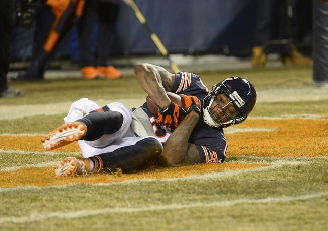 Dec 9, 2013; Chicago, IL, USA; Chicago Bears wide receiver Brandon Marshall (15) makes a catch against Dallas Cowboys cornerback Brandon Carr (39) during the fourth quarter at Soldier Field. Mandatory Credit: Mike DiNovo-USA TODAY Sports