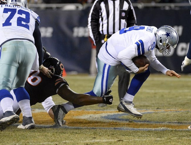 Dec 9, 2013; Chicago, IL, USA; Dallas Cowboys quarterback Tony Romo (9) is sacked by Chicago Bears nose tackle Jeremiah Ratliff (96) during the fourth quarter at Soldier Field. Mandatory Credit: Mike DiNovo-USA TODAY Sports