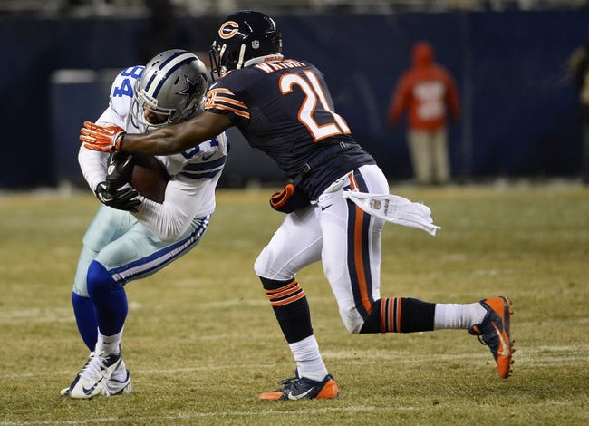 Dec 9, 2013; Chicago, IL, USA; Chicago Bears strong safety Major Wright (21) makes a tackle on Dallas Cowboys tight end James Hanna (84) during the fourth quarter at Soldier Field. Mandatory Credit: Mike DiNovo-USA TODAY Sports