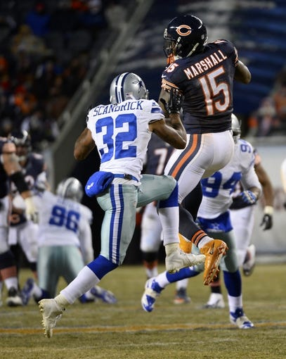 Dec 9, 2013; Chicago, IL, USA; Chicago Bears wide receiver Brandon Marshall (15) makes a catch against Dallas Cowboys cornerback Orlando Scandrick (32) during the fourth quarter at Soldier Field. Mandatory Credit: Mike DiNovo-USA TODAY Sports