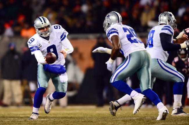 Dec 9, 2013; Chicago, IL, USA; Dallas Cowboys quarterback Tony Romo (9) hands the ball off to running back DeMarco Murray (29) during the second quarter against the Dallas Cowboys at Soldier Field. Mandatory Credit: Andrew Weber-USA TODAY Sports