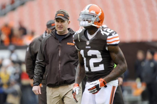 Dec 1, 2013; Cleveland, OH, USA; Cleveland Browns head coach Rob Chudzinski and wide receiver Josh Gordon (12) before the game against the Jacksonville Jaguars at FirstEnergy Stadium. Mandatory Credit: Ken Blaze-USA TODAY Sports