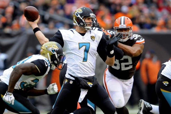 Dec 1, 2013; Cleveland, OH, USA; Jacksonville Jaguars quarterback Chad Henne (7) throws a pass against the Cleveland Browns at FirstEnergy Stadium. Mandatory Credit: Ken Blaze-USA TODAY Sports