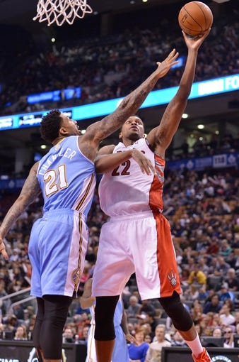 Dec 1, 2013; Toronto, Ontario, CAN; Toronto Raptors small forward Rudy Gay (22) takes a shot over the defense of Denver Nuggets small forward Wilson Chandler (21) in the third quarter of a game at the Air Canada Centre. Mandatory Credit: Mark Konezny-USA TODAY Sports