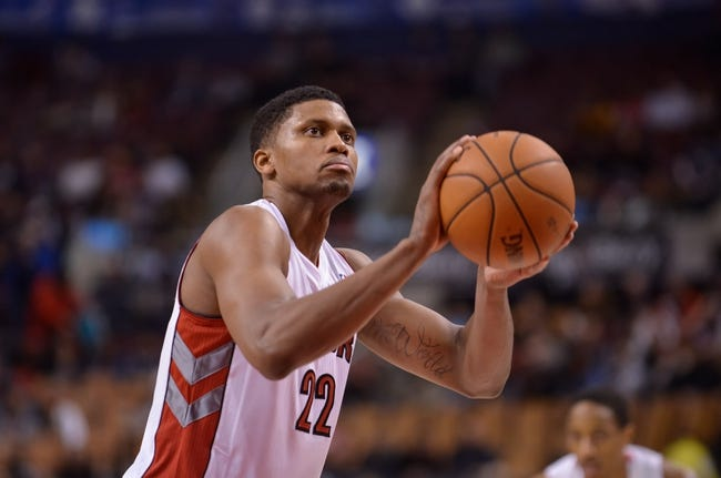 Dec 1, 2013; Toronto, Ontario, CAN; Toronto Raptors small forward Rudy Gay (22) takes a free throw shot during the fourth quarter of a game against the Denver Nuggets at the Air Canada Centre. Denver won the game 112-98. Mandatory Credit: Mark Konezny-USA TODAY Sports