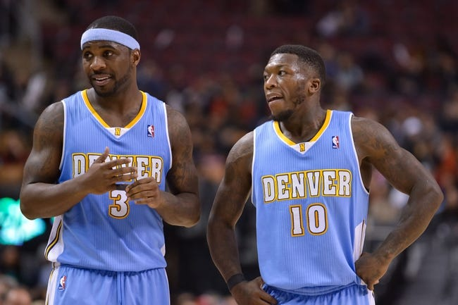Dec 1, 2013; Toronto, Ontario, CAN; Denver Nuggets point guard Ty Lawson (3) and point guard Nate Robinson (10) relax during a timeout in the fourth quarter of a game against the Toronto Raptors at the Air Canada Centre. Denver won the game 112-98. Mandatory Credit: Mark Konezny-USA TODAY Sports