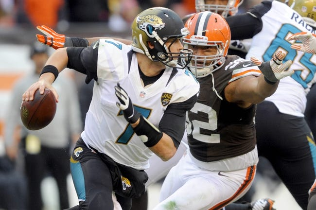 Dec 1, 2013; Cleveland, OH, USA; Jacksonville Jaguars quarterback Chad Henne (7) and Cleveland Browns defensive end Desmond Bryant (92) at FirstEnergy Stadium. Mandatory Credit: Ken Blaze-USA TODAY Sports