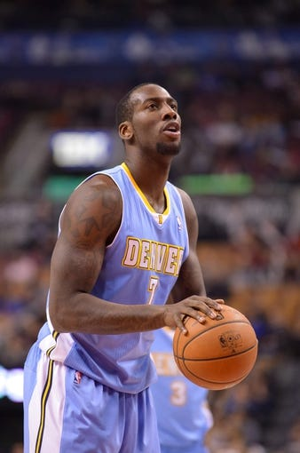 Dec 1, 2013; Toronto, Ontario, CAN; Denver Nuggets power forward J.J. Hickson (7) at the free throw line in the first quarter of a game against the Toronto Raptors at the Air Canada Centre. Mandatory Credit: Mark Konezny-USA TODAY Sports