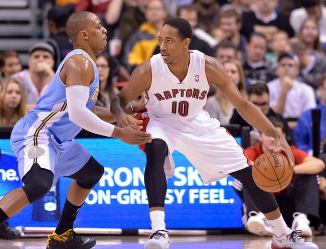 Dec 1, 2013; Toronto, Ontario, CAN; Toronto Raptors shooting guard DeMar DeRozan (10) tries to drive the ball past Denver Nuggets shooting guard Randy Foye (4) in the first quarter of a game at the Air Canada Centre. Mandatory Credit: Mark Konezny-USA TODAY Sports