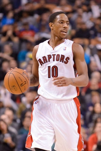 Dec 1, 2013; Toronto, Ontario, CAN; Toronto Raptors shooting guard DeMar DeRozan (10) brings the ball up court during the third quarter of a game against the Denver Nuggets at the Air Canada Centre. Denver won the game 112-98. Mandatory Credit: Mark Konezny-USA TODAY Sports