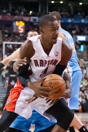 Dec 1, 2013; Toronto, Ontario, CAN; Toronto Raptors shooting guard Terrence Ross (31) is fouled while trying to take a shot in the fourth quarter of a game against the Denver Nuggets at the Air Canada Centre. Denver won the game 112-98. Mandatory Credit: Mark Konezny-USA TODAY Sports