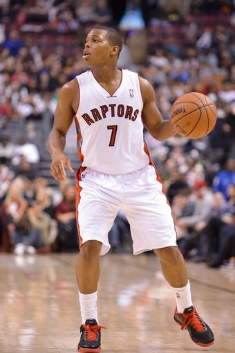 Dec 1, 2013; Toronto, Ontario, CAN; Toronto Raptors point guard Kyle Lowry (7) looks to make a pass in the second quarter of a game against the Denver Nuggets at the Air Canada Centre. Mandatory Credit: Mark Konezny-USA TODAY Sports