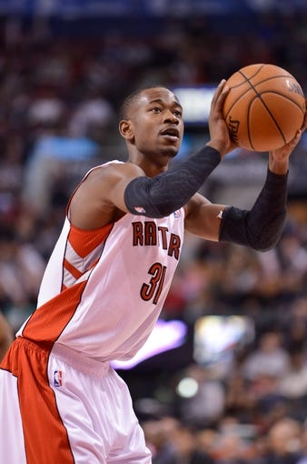 Dec 1, 2013; Toronto, Ontario, CAN; Toronto Raptors shooting guard Terrence Ross (31) at the free throw line during the fourth quarter of a game against the Denver Nuggets at the Air Canada Centre. Denver won the game 112-98. Mandatory Credit: Mark Konezny-USA TODAY Sports