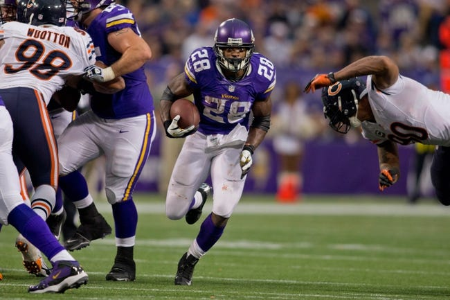 Dec 1, 2013; Minneapolis, MN, USA; Minnesota Vikings running back Adrian Peterson (28) rushes for 18 yards against the Chicago Bears in the third quarter at Mall of America Field at H.H.H. Metrodome. This run marked his 10,000 yards in career rushing. Vikings win 23-20 in overtime. Mandatory Credit: Bruce Kluckhohn-USA TODAY Sports