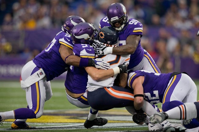 Dec 1, 2013; Minneapolis, MN, USA; Minnesota Vikings linebacker Chad Greenway (52) and linebacker Audie Cole (57) and linebacker Audie Cole (57) and defensive tackle Sharrif Floyd (95) stop Chicago Bears running back Matt Forte (22) in the second quarter at Mall of America Field at H.H.H. Metrodome. Vikings win 23-20 in overtime. Mandatory Credit: Bruce Kluckhohn-USA TODAY Sports