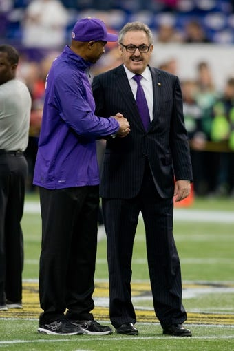 Dec 1, 2013; Minneapolis, MN, USA; Minnesota Vikings head coach Leslie Frazier talks with owner Zygi Wilf before the game with the Chicago Bears at Mall of America Field at H.H.H. Metrodome. Vikings win 23-20 in overtime. Mandatory Credit: Bruce Kluckhohn-USA TODAY Sports