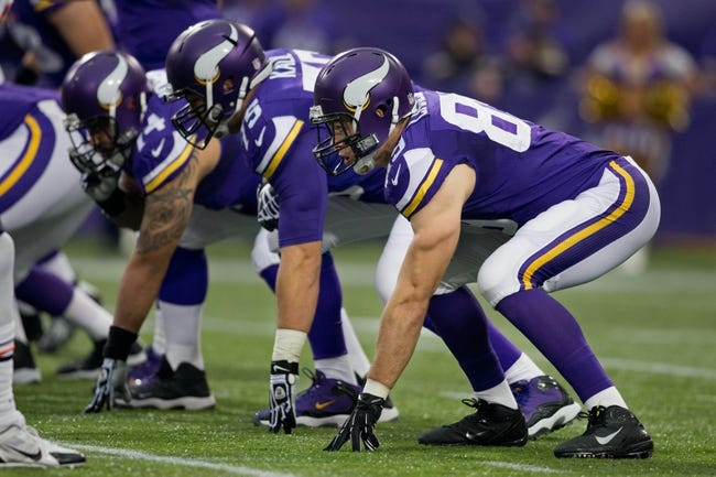 Dec 1, 2013; Minneapolis, MN, USA; Minnesota Vikings tight end John Carlson (89) gets ready to block against the Chicago Bears in the first quarter at Mall of America Field at H.H.H. Metrodome. Vikings win 23-20 in overtime. Mandatory Credit: Bruce Kluckhohn-USA TODAY Sports