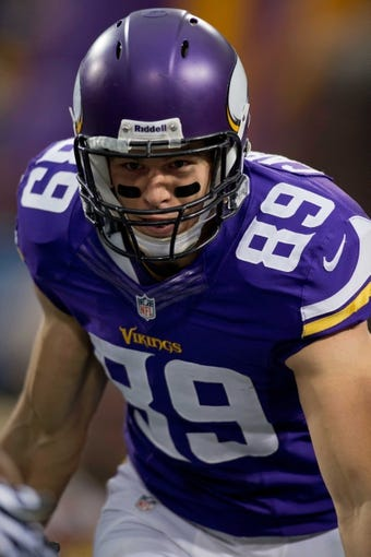 Dec 1, 2013; Minneapolis, MN, USA; Minnesota Vikings tight end John Carlson (89) rushes onto the field to play against the Chicago Bears at Mall of America Field at H.H.H. Metrodome. Vikings win 23-20 in overtime. Mandatory Credit: Bruce Kluckhohn-USA TODAY Sports