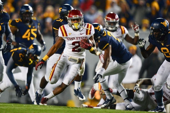 Nov 30, 2013; Morgantown, WV, USA; Iowa State Cyclones running back Aaron Wimberly (2) runs with the ball during the second half of the game against West Virginia Mountaineers at Milan Puskar Stadium. The Iowa State Cyclones defeated West Virginia Mountaineers 52-44 in the third overtime. Mandatory Credit: Tommy Gilligan-USA TODAY Sports