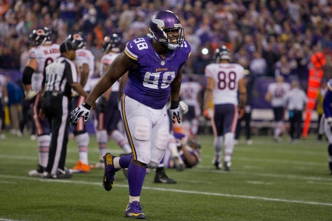 Dec 1, 2013; Minneapolis, MN, USA; Minnesota Vikings defensive tackle Letroy Guion (98) celebrates the missed field goal by the Chicago Bears in overtime at Mall of America Field at H.H.H. Metrodome. Vikings win 23-20 in overtime. Mandatory Credit: Bruce Kluckhohn-USA TODAY Sports