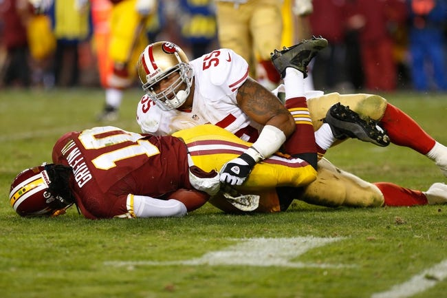 Nov 25, 2013; Landover, MD, USA; San Francisco 49ers outside linebacker Ahmad Brooks (55) tackles Washington Redskins quarterback Robert Griffin III (10) at FedEx Field. Mandatory Credit: Geoff Burke-USA TODAY Sports