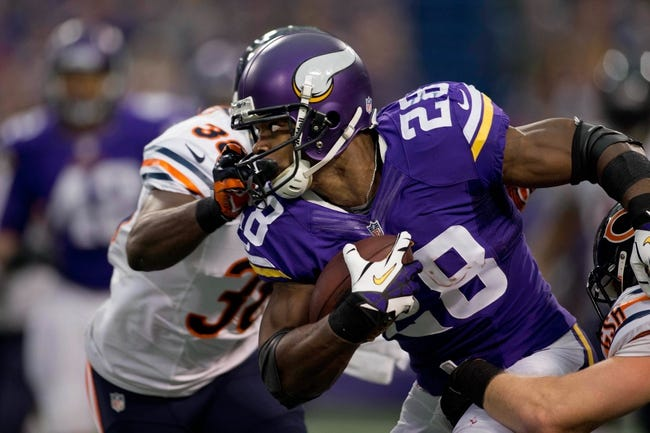 Dec 1, 2013; Minneapolis, MN, USA; Minnesota Vikings running back Adrian Peterson (28) rushes against the Chicago Bears for 5 yards in the first quarter at Mall of America Field at H.H.H. Metrodome. Vikings win 23-20 in overtime. Mandatory Credit: Bruce Kluckhohn-USA TODAY Sports