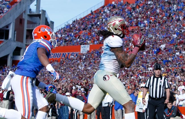 Nov 30, 2013; Gainesville, FL, USA; Florida State Seminoles wide receiver Kelvin Benjamin (1) catches the ball for a touchdown against the Florida Gators during the second half at Ben Hill Griffin Stadium. Florida State Seminoles defeated the Florida Gators 37-7. Mandatory Credit: Kim Klement-USA TODAY Sports