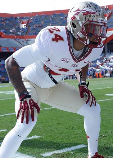 Nov 30, 2013; Gainesville, FL, USA; Florida State Seminoles linebacker Terrance Smith (24) works out prior to the game against the Florida Gators at Ben Hill Griffin Stadium. Mandatory Credit: Kim Klement-USA TODAY Sports