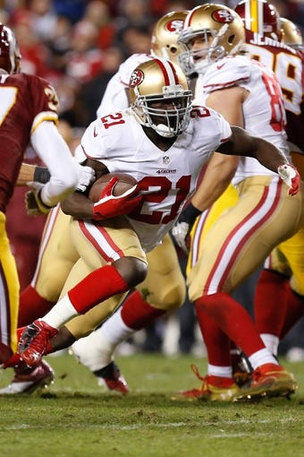 Nov 25, 2013; Landover, MD, USA; San Francisco 49ers running back Frank Gore (21) runs with the ball against the Washington Redskins at FedEx Field. Mandatory Credit: Geoff Burke-USA TODAY Sports