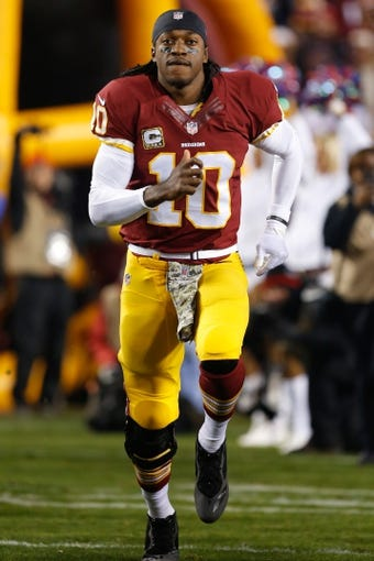 Nov 25, 2013; Landover, MD, USA; Washington Redskins quarterback Robert Griffin III (10) runs onto the field prior to the Redskins game against the San Francisco 49ers at FedEx Field. Mandatory Credit: Geoff Burke-USA TODAY Sports
