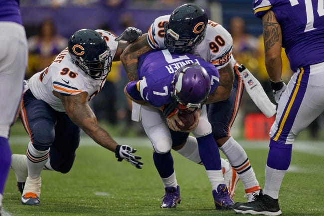 Dec 1, 2013; Minneapolis, MN, USA; Chicago Bears defensive end Julius Peppers (90) tackles Minnesota Vikings quarterback Christian Ponder (7) for a sack as defensive tackle Jay Ratliff (96) comes in in the first quarter at Mall of America Field at H.H.H. Metrodome. Vikings win 23-20 in overtime. Mandatory Credit: Bruce Kluckhohn-USA TODAY Sports