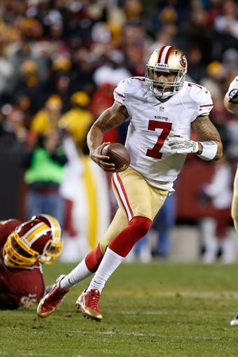 Nov 25, 2013; Landover, MD, USA; San Francisco 49ers quarterback Colin Kaepernick (7) runs with the ball against the Washington Redskins at FedEx Field. Mandatory Credit: Geoff Burke-USA TODAY Sports