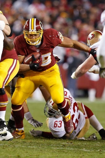 Nov 25, 2013; Landover, MD, USA; Washington Redskins running back Roy Helu (29) run with the ball against the San Francisco 49ers at FedEx Field. Mandatory Credit: Geoff Burke-USA TODAY Sports