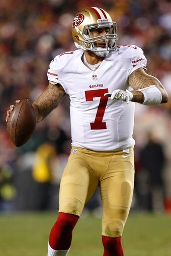 Nov 25, 2013; Landover, MD, USA; San Francisco 49ers quarterback Colin Kaepernick (7) prepares to throw the ball against the Washington Redskins at FedEx Field. Mandatory Credit: Geoff Burke-USA TODAY Sports