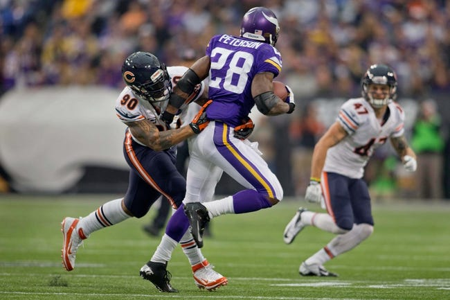 Dec 1, 2013; Minneapolis, MN, USA; Chicago Bears defensive end Julius Peppers (90) stops Minnesota Vikings running back Adrian Peterson (28) in the second quarter at Mall of America Field at H.H.H. Metrodome. Vikings win 23-20 in overtime. Mandatory Credit: Bruce Kluckhohn-USA TODAY Sports