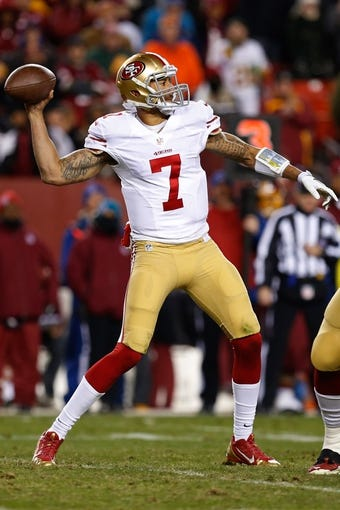 Nov 25, 2013; Landover, MD, USA; San Francisco 49ers quarterback Colin Kaepernick (7) throws the ball against the Washington Redskins at FedEx Field. Mandatory Credit: Geoff Burke-USA TODAY Sports
