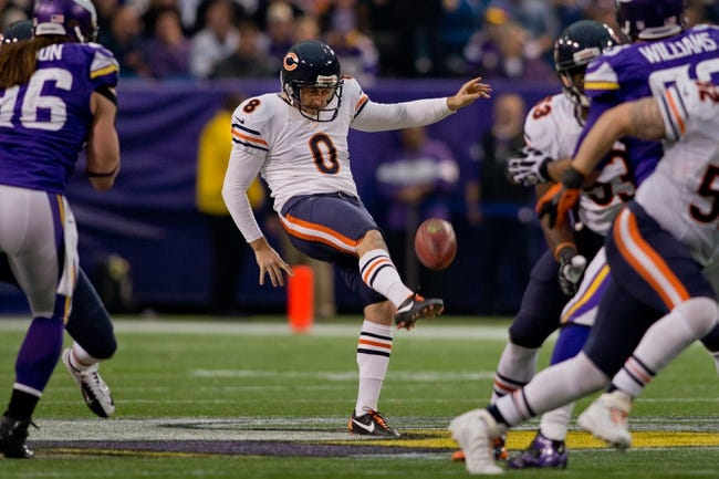 Dec 1, 2013; Minneapolis, MN, USA; Chicago Bears punter Adam Podlesh (8) punts to the Minnesota Vikings in the third quarter at Mall of America Field at H.H.H. Metrodome. Vikings win 23-20 in overtime. Mandatory Credit: Bruce Kluckhohn-USA TODAY Sports