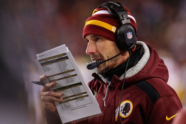 Nov 25, 2013; Landover, MD, USA; Washington Redskins offensive coordinator Kyle Shanahan calls a play from the sidelines against the San Francisco 49ers at FedEx Field. Mandatory Credit: Geoff Burke-USA TODAY Sports