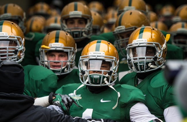 Dec 7, 2013; Waco, TX, USA; The Baylor Bears prepare to take the field to face the Texas Longhorns at Floyd Casey Stadium. The Baylor Bears defeated the Texas Longhorns 30-10 to win the Big 12 championship. Mandatory Credit: Jerome Miron-USA TODAY Sports