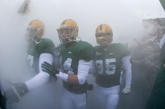 Dec 7, 2013; Waco, TX, USA; Baylor Bears defensive lineman Tanner Thrift (57) and wide receiver Lynx Hawthorne (84) and defensive lineman Beau Blackshear (95) take the field to face the Texas Longhorns at Floyd Casey Stadium. The Baylor Bears defeated the Texas Longhorns 30-10 to win the Big 12 championship. Mandatory Credit: Jerome Miron-USA TODAY Sports