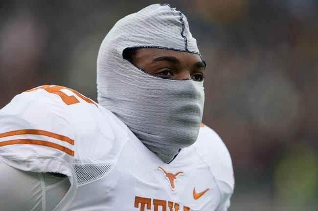 Dec 7, 2013; Waco, TX, USA; Texas Longhorns defensive end Reggie Wilson (92) before the game against the Baylor Bears at Floyd Casey Stadium. The Baylor Bears defeated the Texas Longhorns 30-10 to win the Big 12 championship. Mandatory Credit: Jerome Miron-USA TODAY Sports