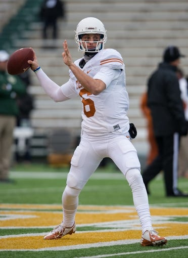 Dec 7, 2013; Waco, TX, USA; Texas Longhorns quarterback Case McCoy (6) before the game against the Baylor Bears at Floyd Casey Stadium. The Baylor Bears defeated the Texas Longhorns 30-10 to win the Big 12 championship. Mandatory Credit: Jerome Miron-USA TODAY Sports