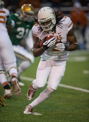 Dec 7, 2013; Waco, TX, USA; Texas Longhorns running back Jalen Overstreet (3) during the game against the Baylor Bears at Floyd Casey Stadium. The Baylor Bears defeated the Texas Longhorns 30-10 to win the Big 12 championship. Mandatory Credit: Jerome Miron-USA TODAY Sports