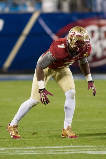 Dec 7, 2013; Charlotte, NC, USA; Florida State Seminoles linebacker Christian Jones (7) lines up against the Duke Blue Devils during the second half at Bank of America Stadium. FSU defeated Duke 45-7. Mandatory Credit: Jeremy Brevard-USA TODAY Sports
