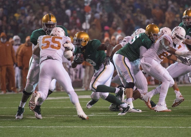 Dec 7, 2013; Waco, TX, USA; Baylor Bears running back Glasco Martin (8) runs through the Texas Longhorns line and scores a touchdown during the game at Floyd Casey Stadium. The Baylor Bears defeated the Texas Longhorns 30-10 to win the Big 12 championship. Mandatory Credit: Jerome Miron-USA TODAY Sports