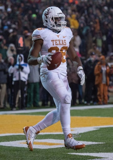 Dec 7, 2013; Waco, TX, USA; Texas Longhorns running back Malcolm Brown (28) scores a touchdown against the Baylor Bears during the game at Floyd Casey Stadium. The Baylor Bears defeated the Texas Longhorns 30-10 to win the Big 12 championship. Mandatory Credit: Jerome Miron-USA TODAY Sports