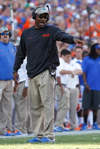 Nov 23, 2013; Gainesville, FL, USA; Florida Gators tight end coach Derek Lewis against the Georgia Southern Eagles during the second quarter at Ben Hill Griffin Stadium. Mandatory Credit: Kim Klement-USA TODAY Sports