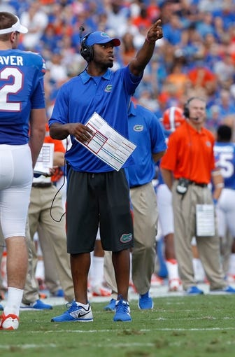 Nov 23, 2013; Gainesville, FL, USA; Florida Gators quarterback Tyler Murphy (3) points against the Georgia Southern Eagles during the first quarter at Ben Hill Griffin Stadium. Mandatory Credit: Kim Klement-USA TODAY Sports
