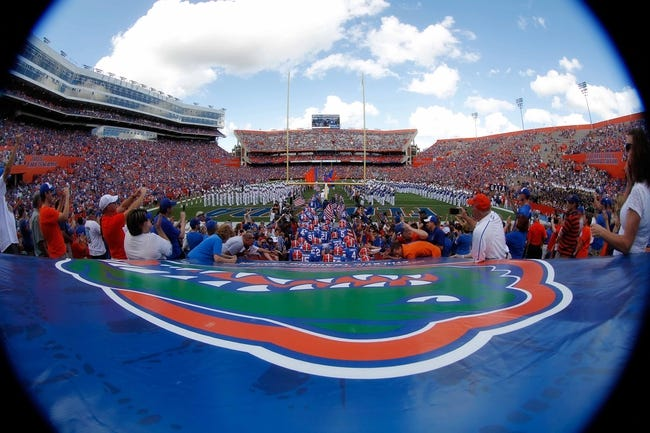 Nov 23, 2013; Gainesville, FL, USA; Florida Gators run out of the tunnel prior to the game against the Georgia Southern Eagles at Ben Hill Griffin Stadium. Mandatory Credit: Kim Klement-USA TODAY Sports